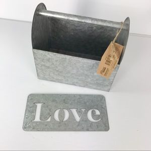 Galvanized metal tote and Love stencil wall decor